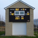 Scoreboard incorporated above machinery store at Silsden CC.